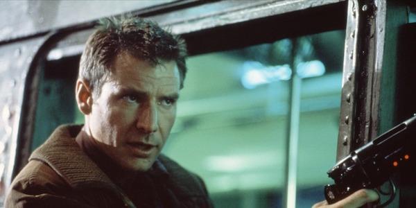Deckard with a gun in Blade Runner